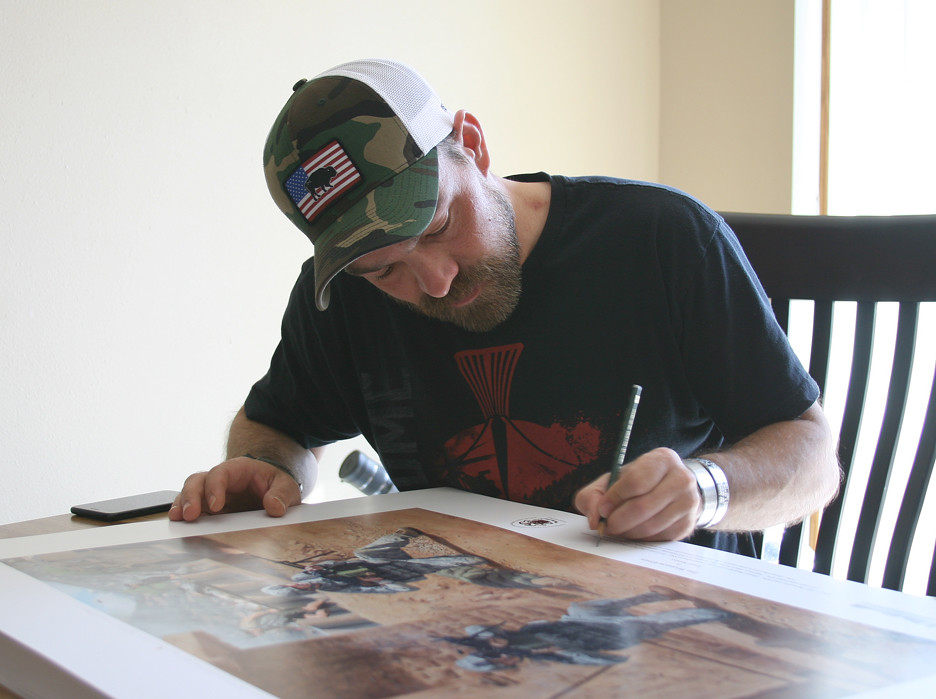 clint-signing-prints